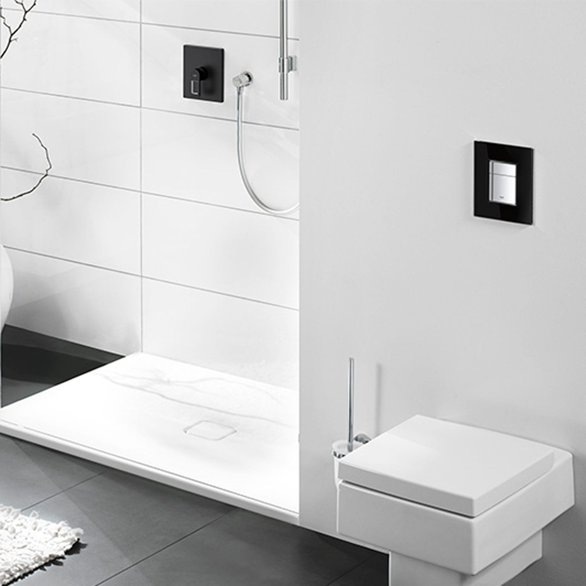 Square flush plate in a grey bathroom.
